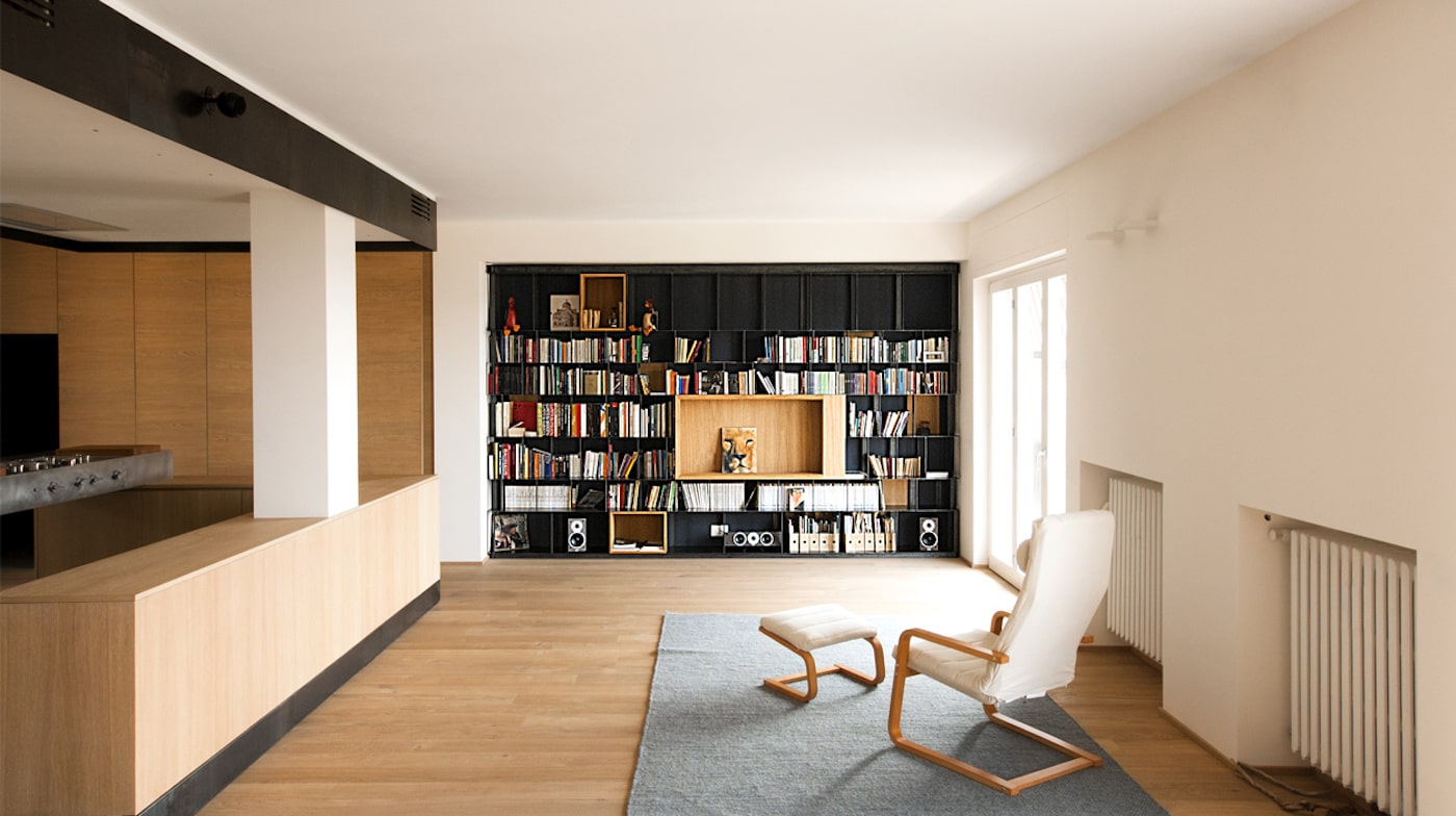 Loungeroom with timber flooring and black bookcase