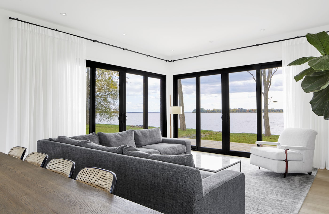 Loungeroom in sustainable house with water view