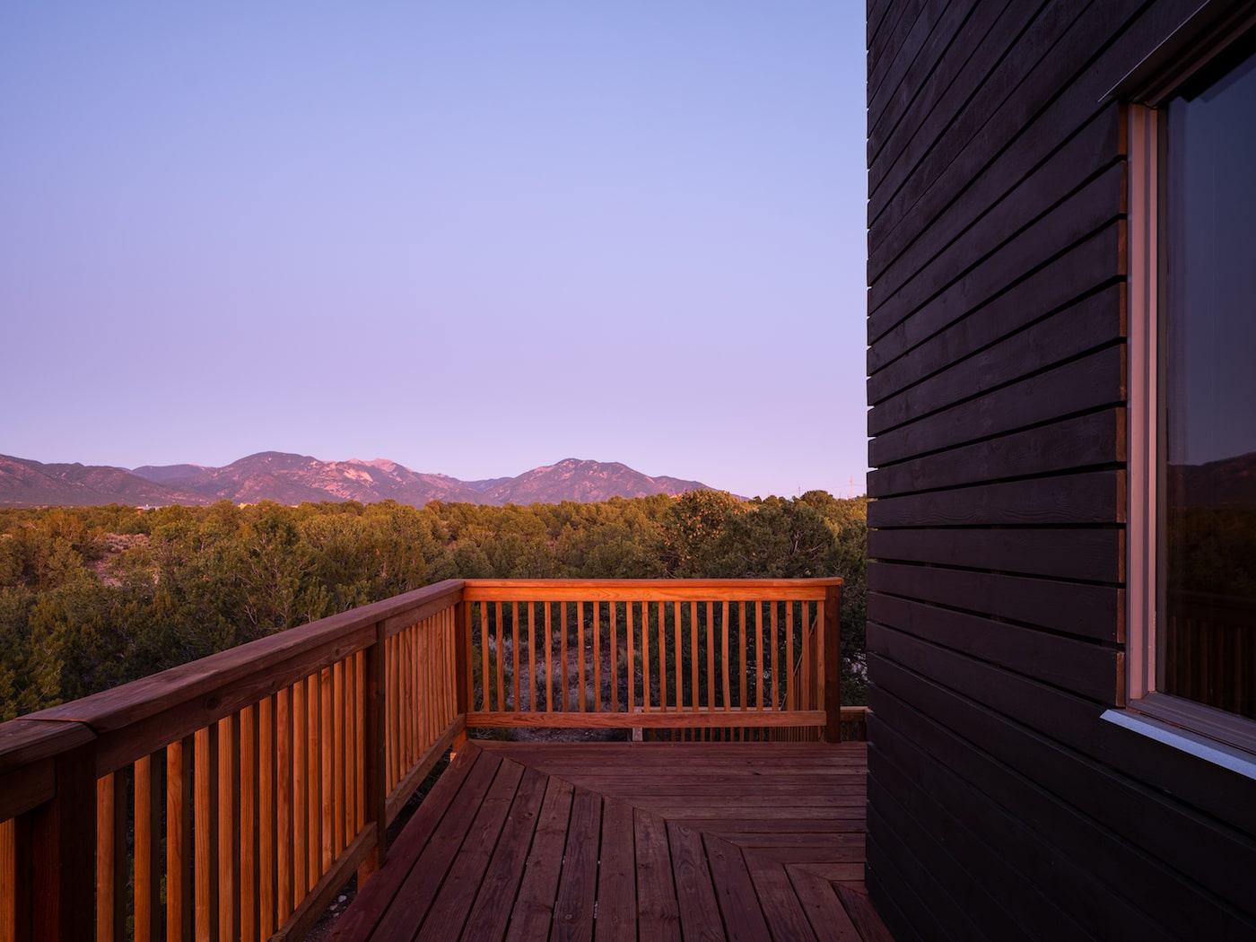 Views of mountain in distance on timber deck
