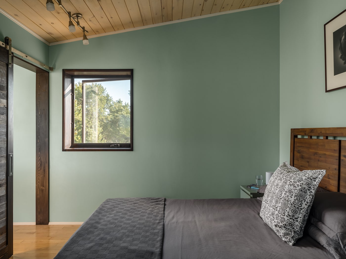 Bedroom with green walls and timber lined ceiling