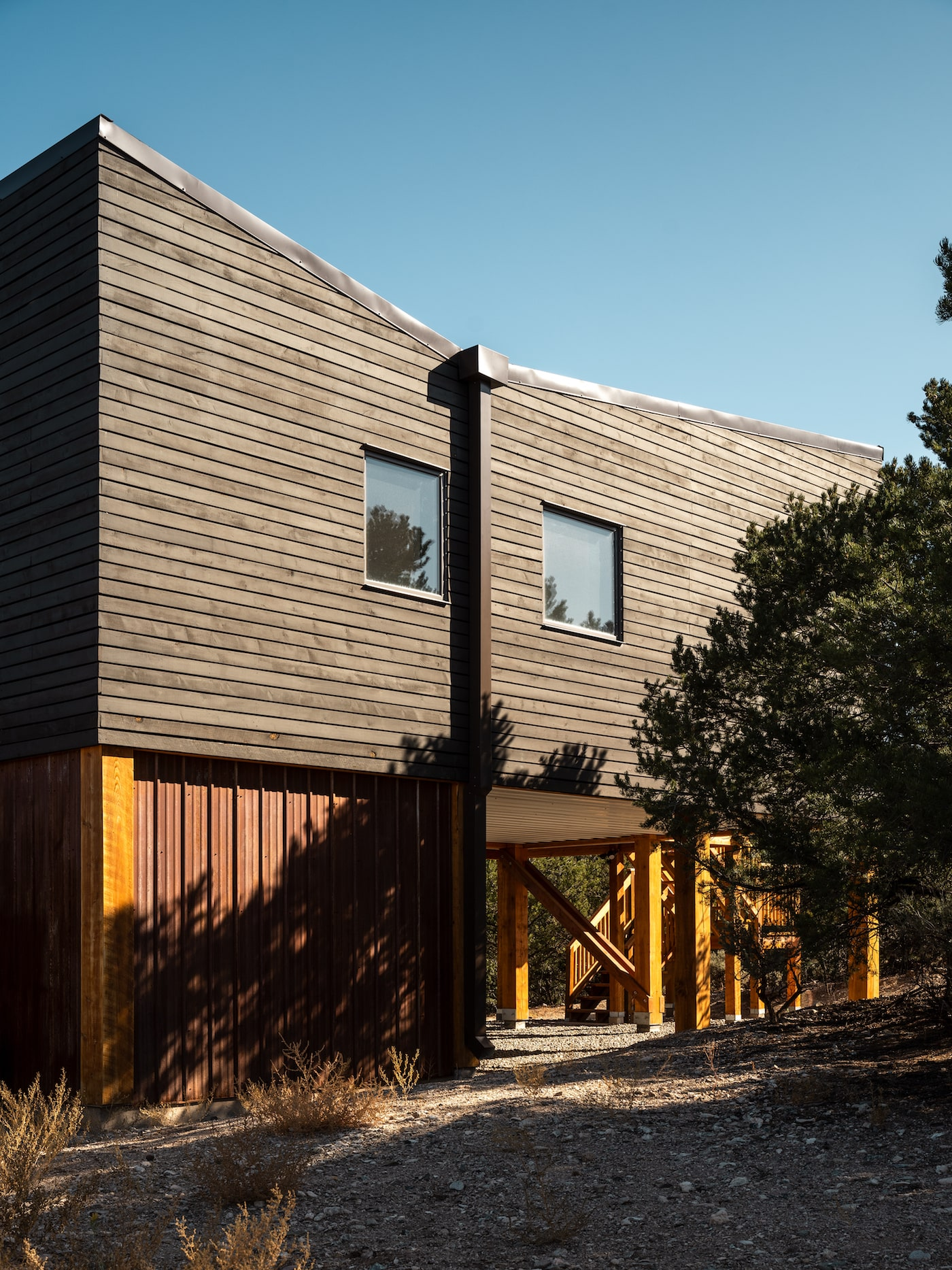 Side view of blackened timber cladding on super-insulated low-tox home