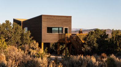 Man on verandah of timber super-insulated low-tox home