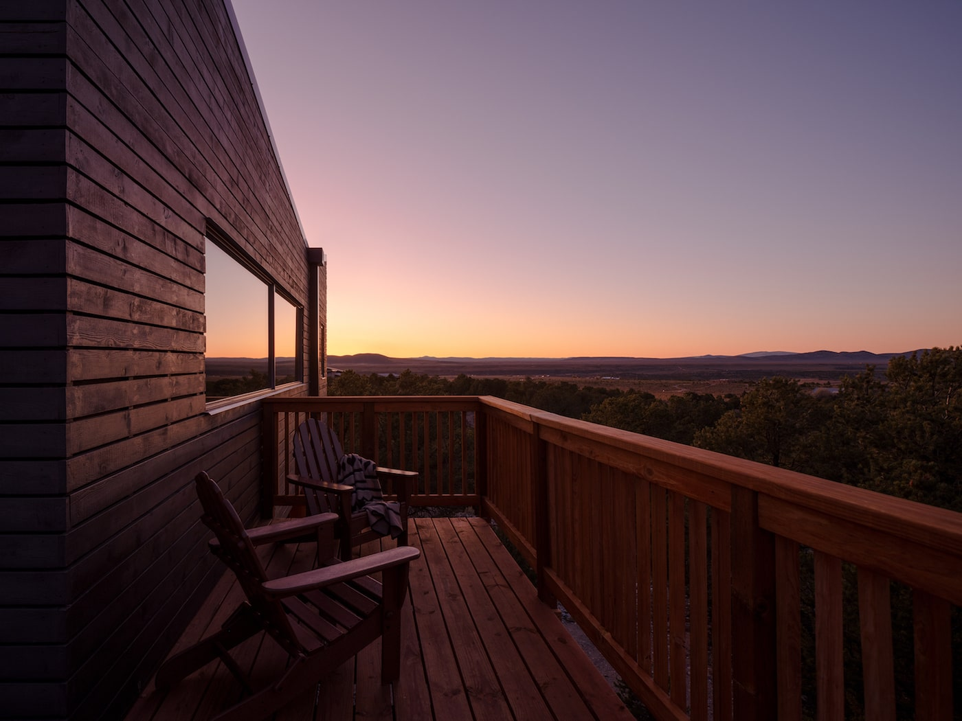 Sunset view from timber deck of super-insulated low-tox home