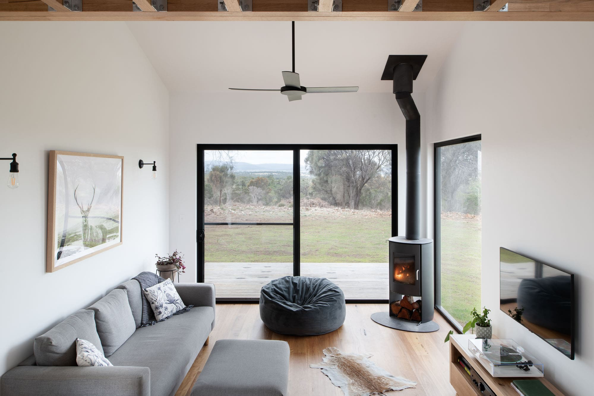 Loungeroom with fireplace in sustainable house