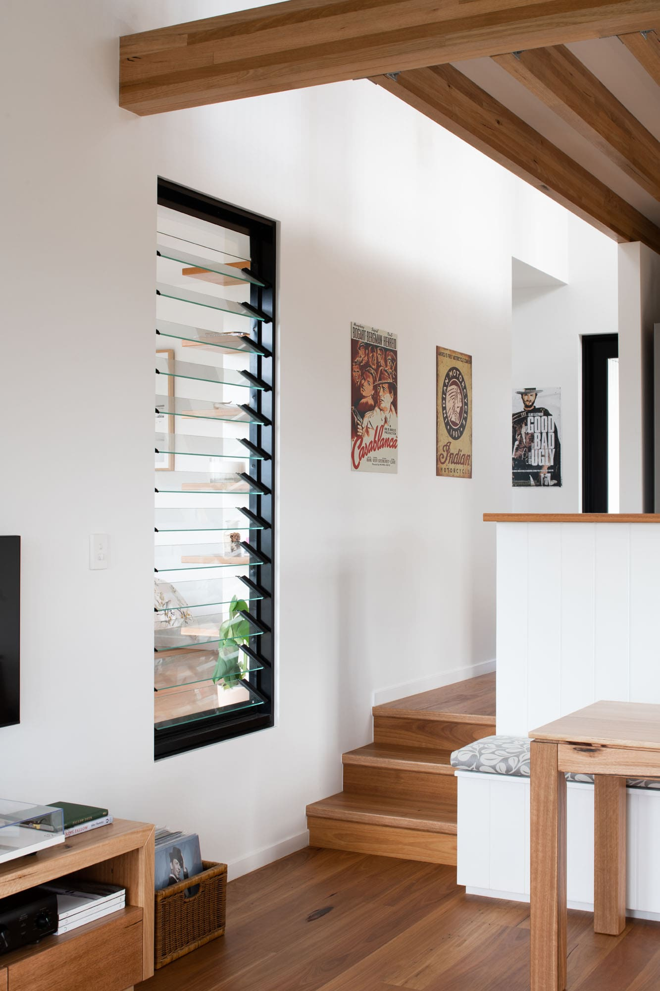 Louvered window and timber flooring in sustainable home