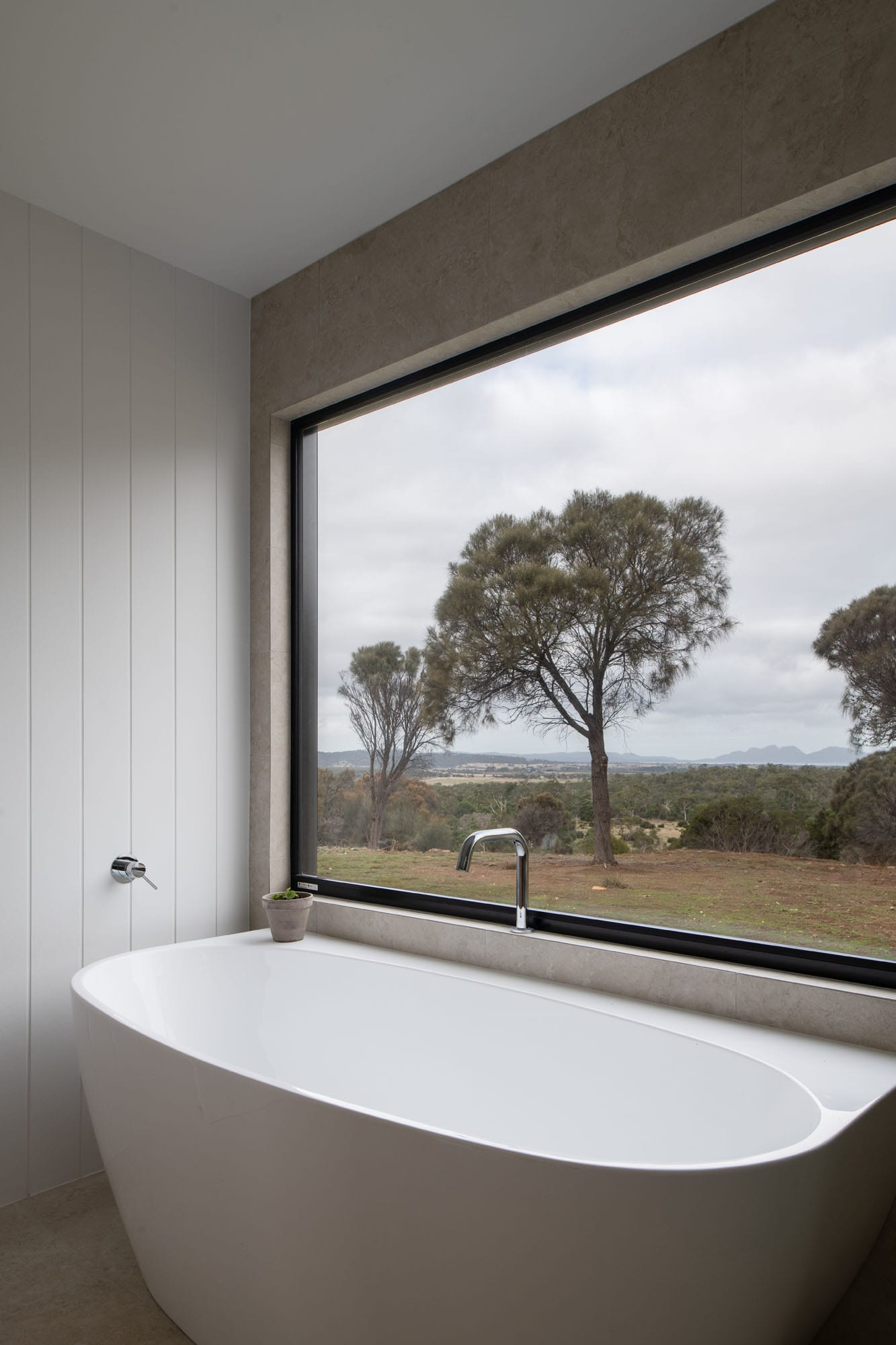 Bath with views of bush in sustainable home
