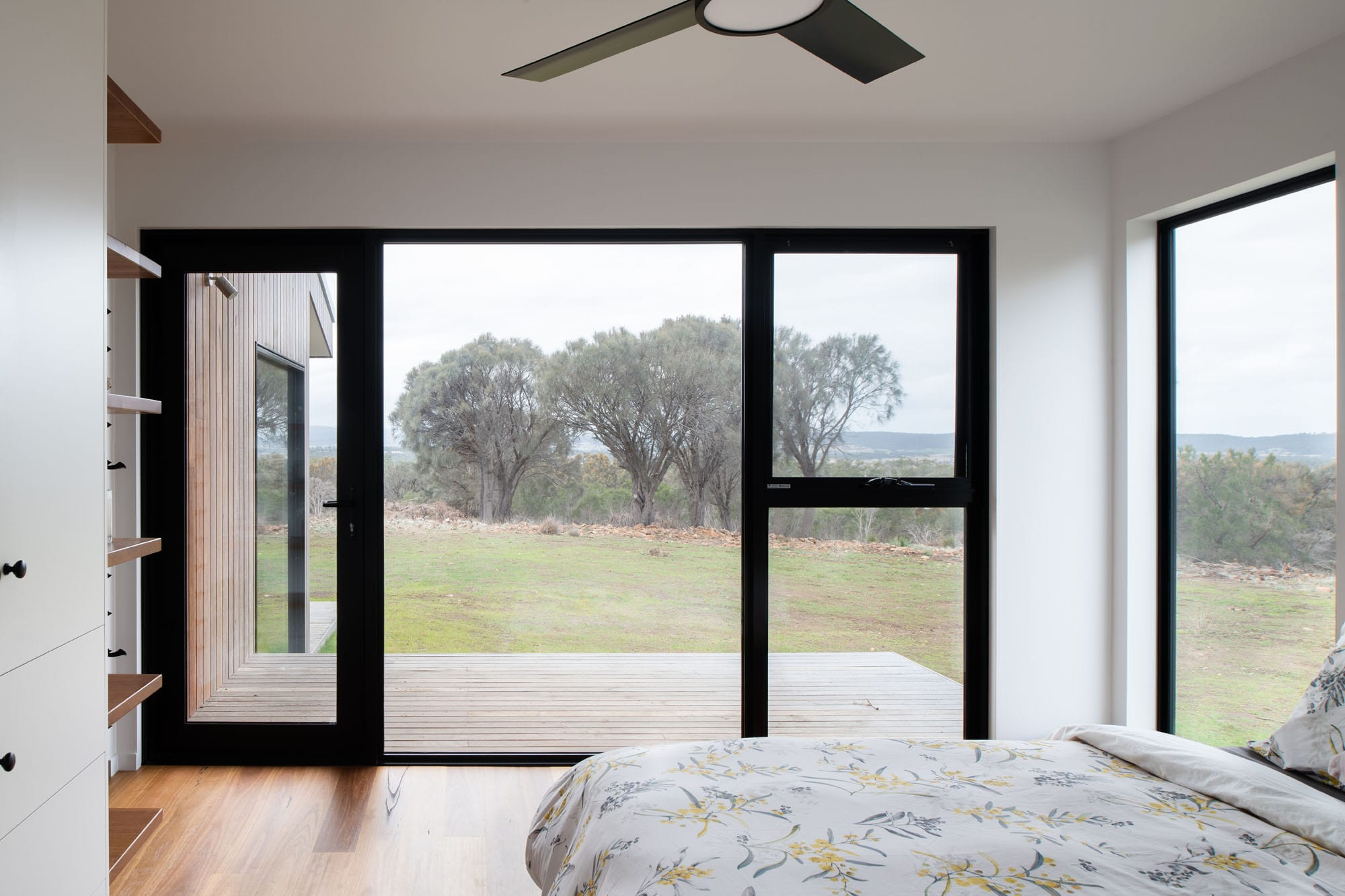 Master bedroom with timber floors in sustainable house
