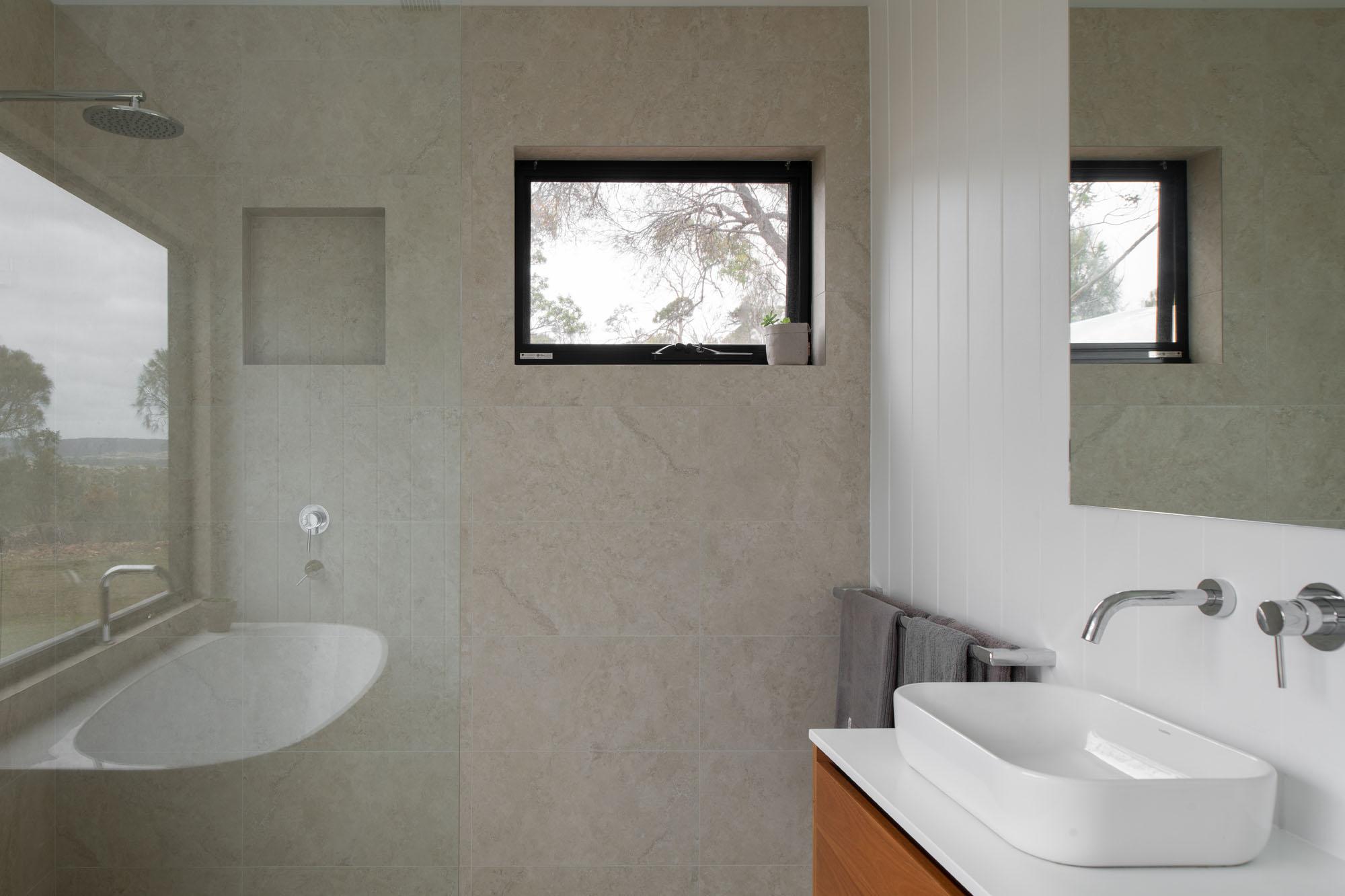 Bathroom vanity and shower in off-grid home