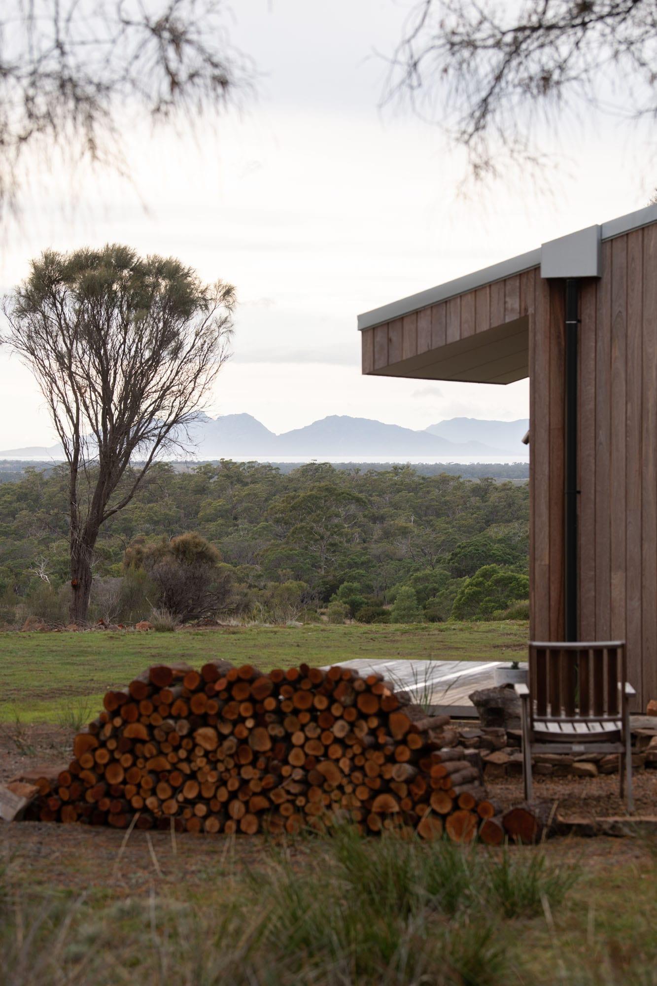 Wood pile outside sustainable house