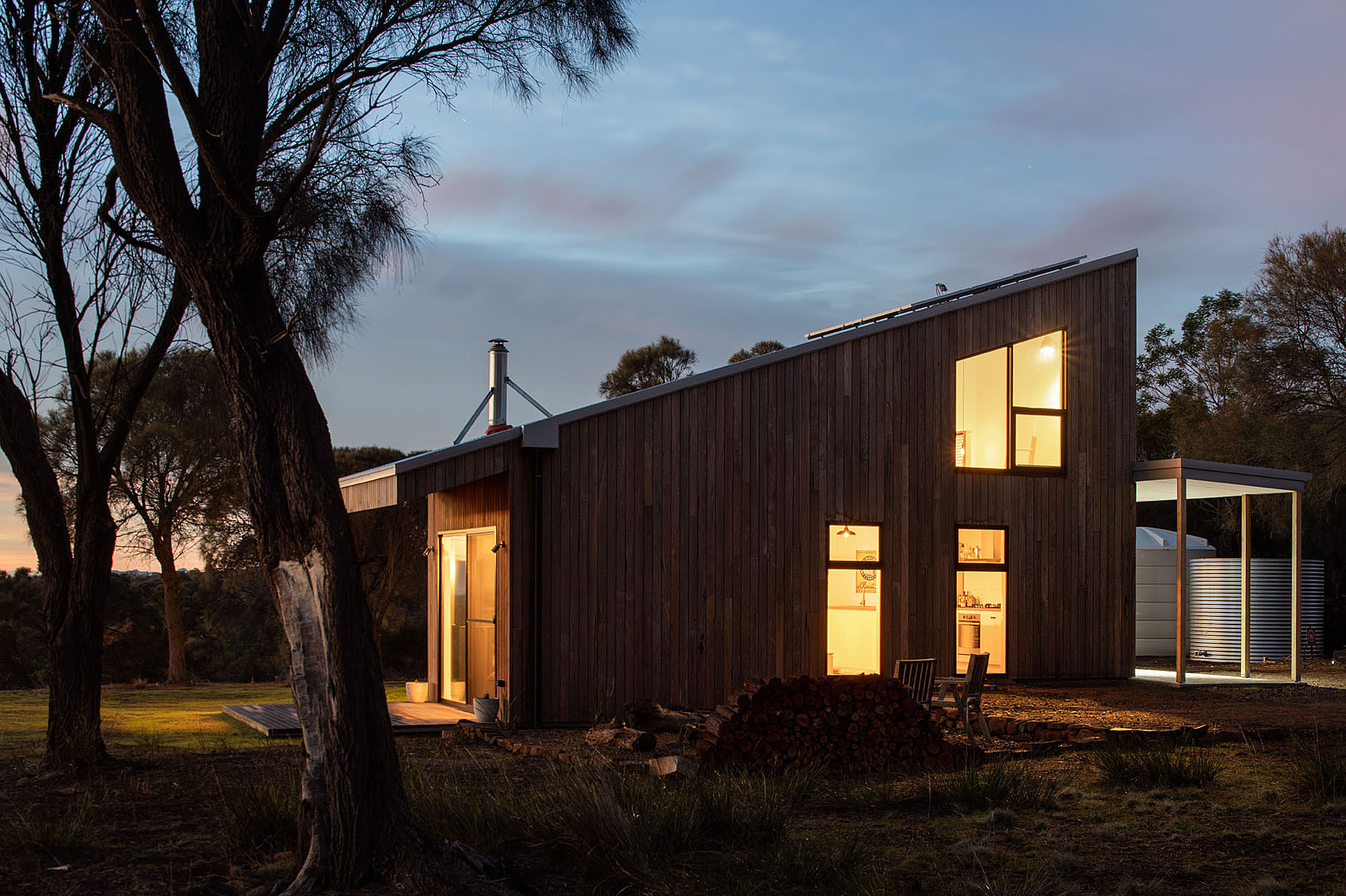 Night view of sustainable house with lights on
