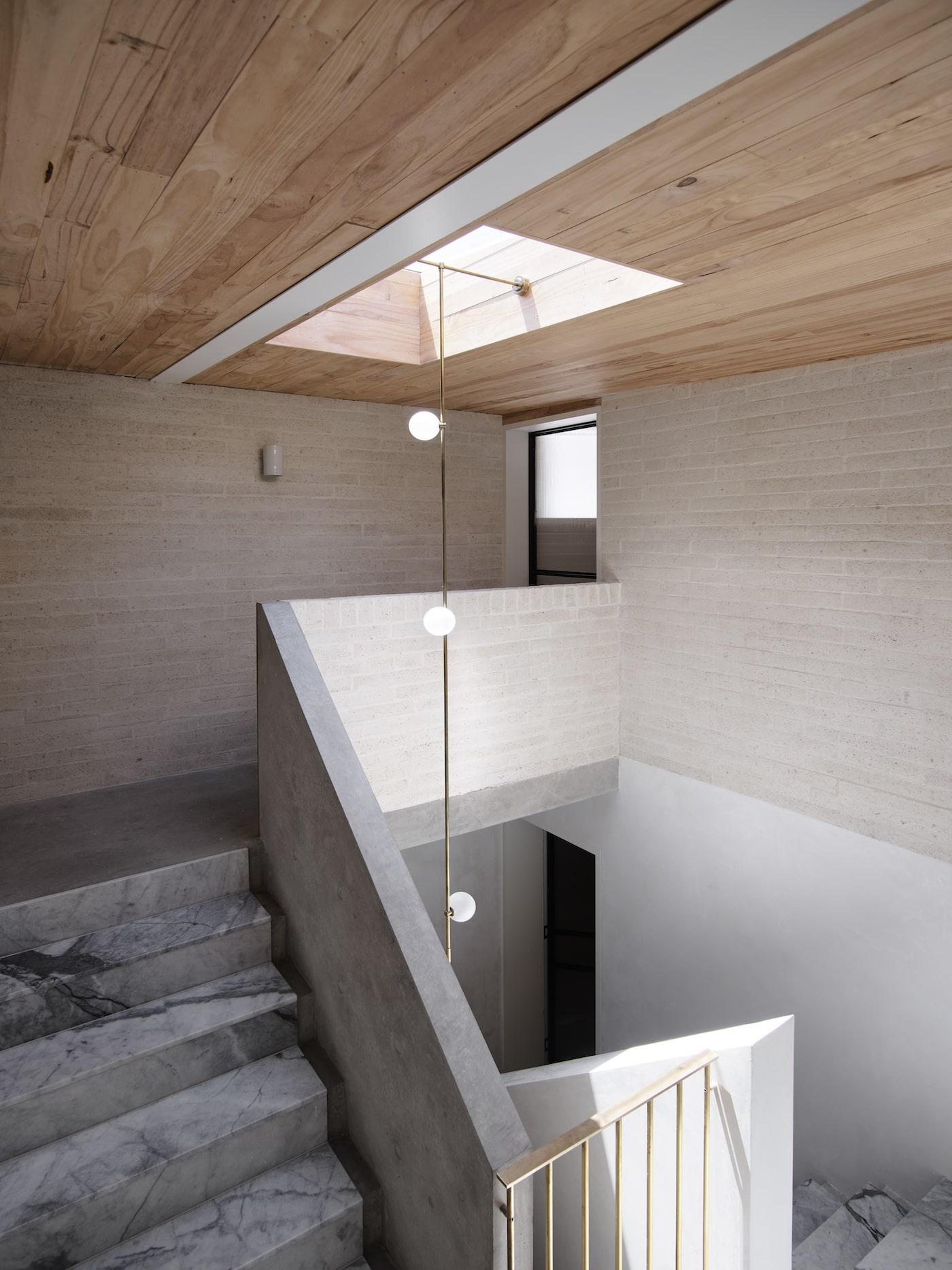 Sustainable masonry bricks in stairwell