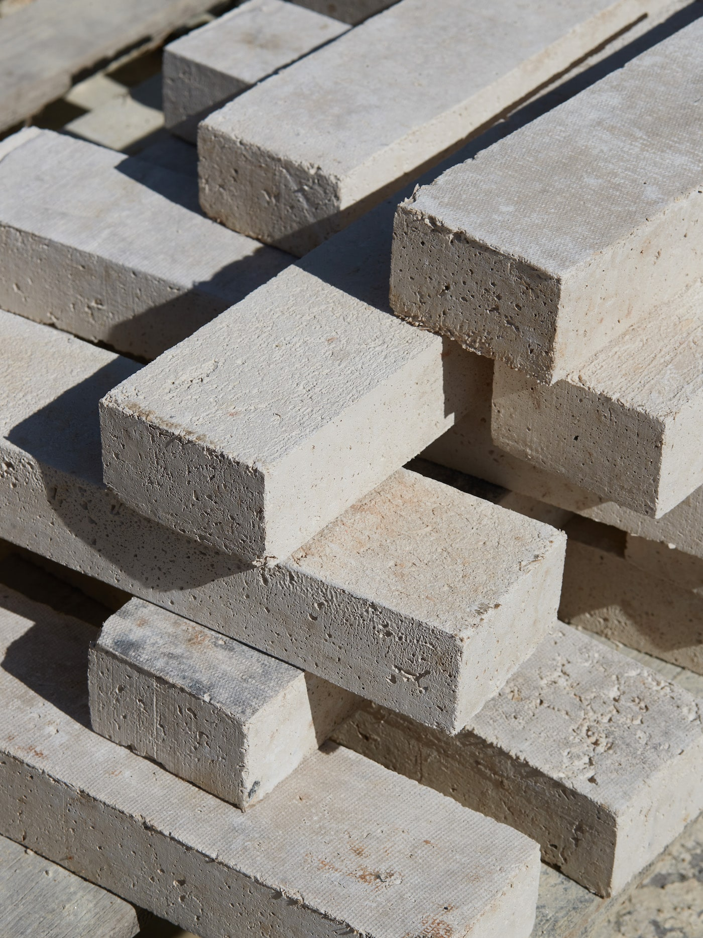 Stack of light coloured sustainable bricks