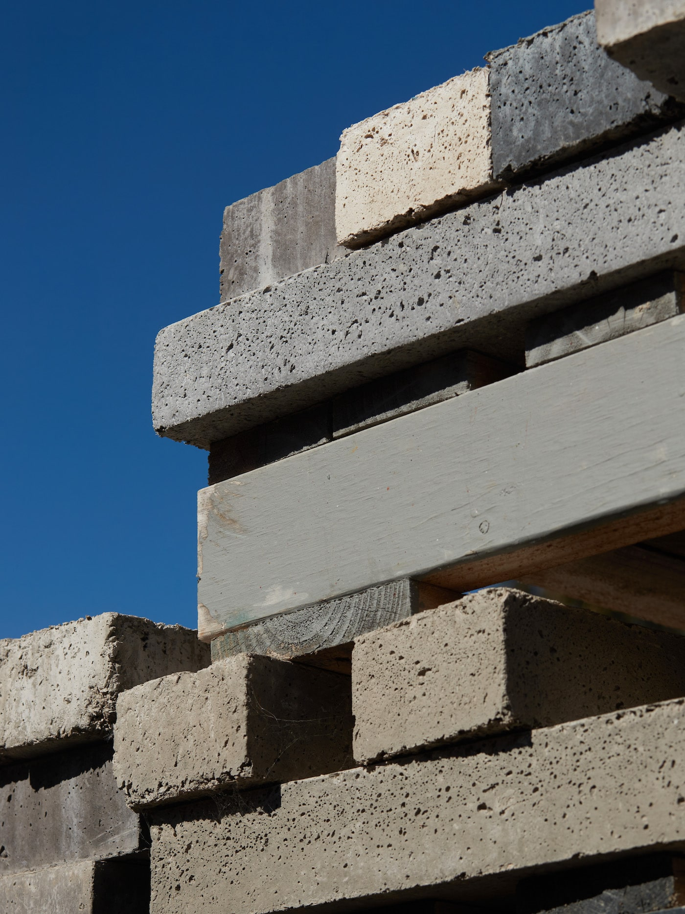 Stack of sustainable bricks in various colours