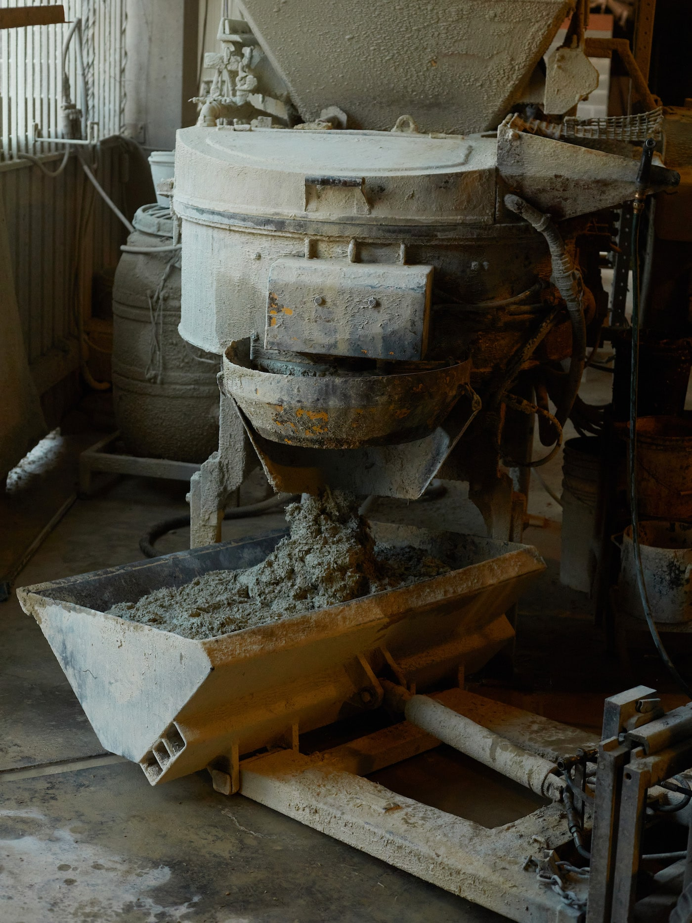 Sustainable masonry mixture pouring out of machine
