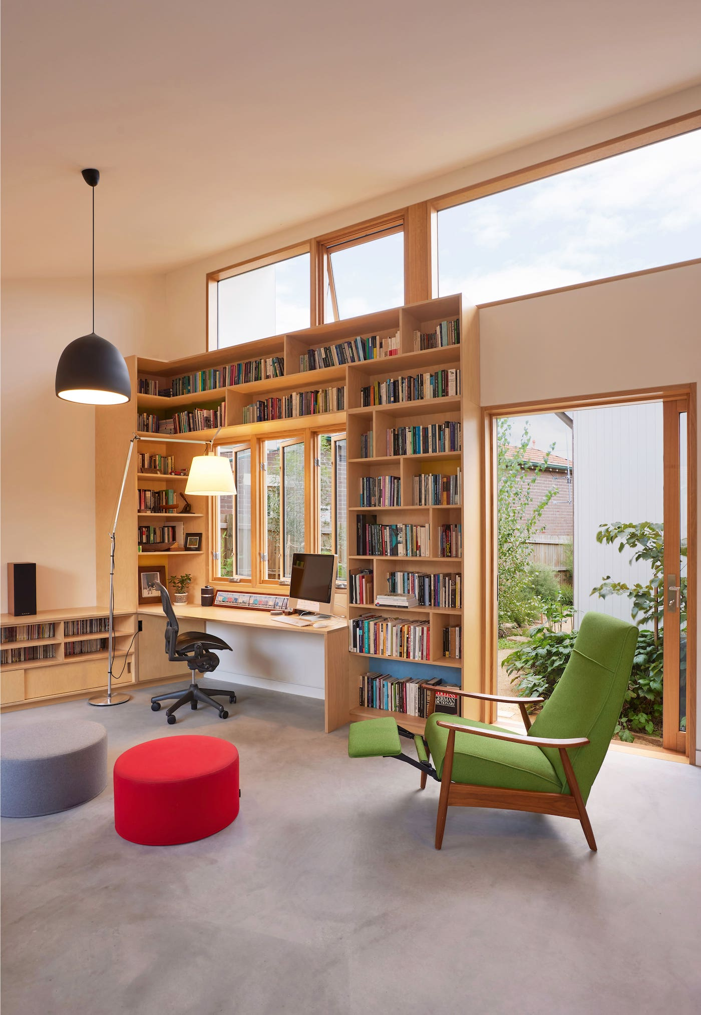 Library wall surrounds desk