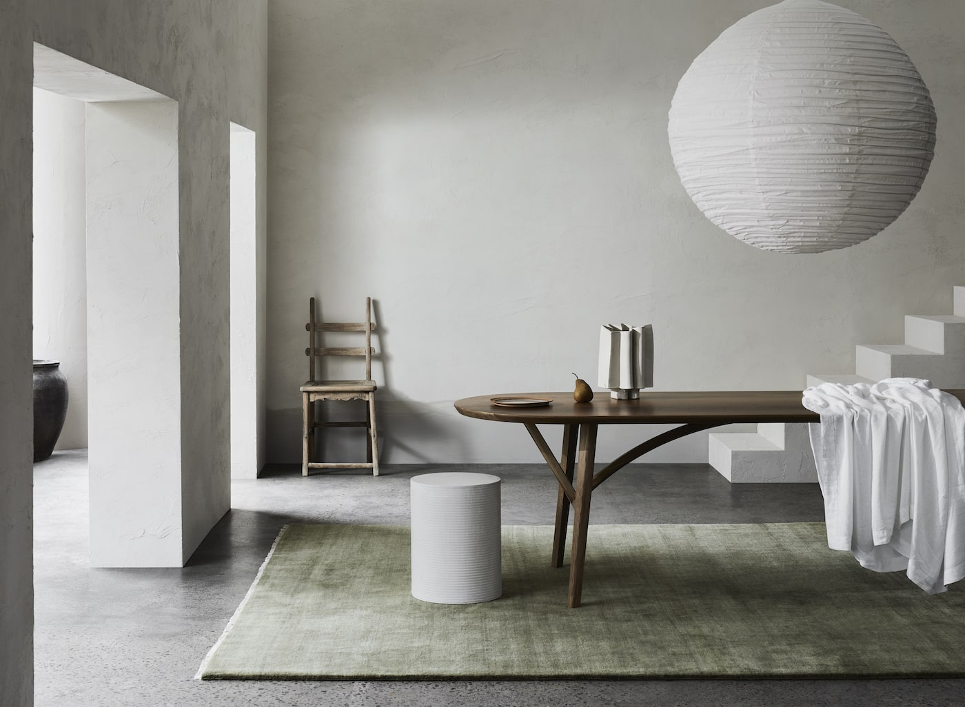 Green rug in dining room under dining table
