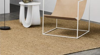 Fawn coloured rug on concrete floor