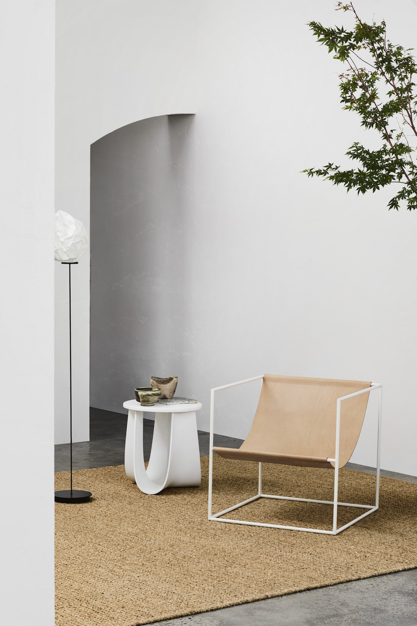 Jute rug on concrete floor and white walls