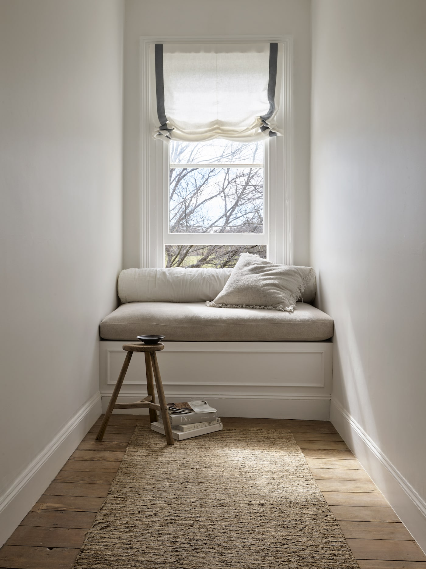 Reading nook with timber floors and natural rectangle rug
