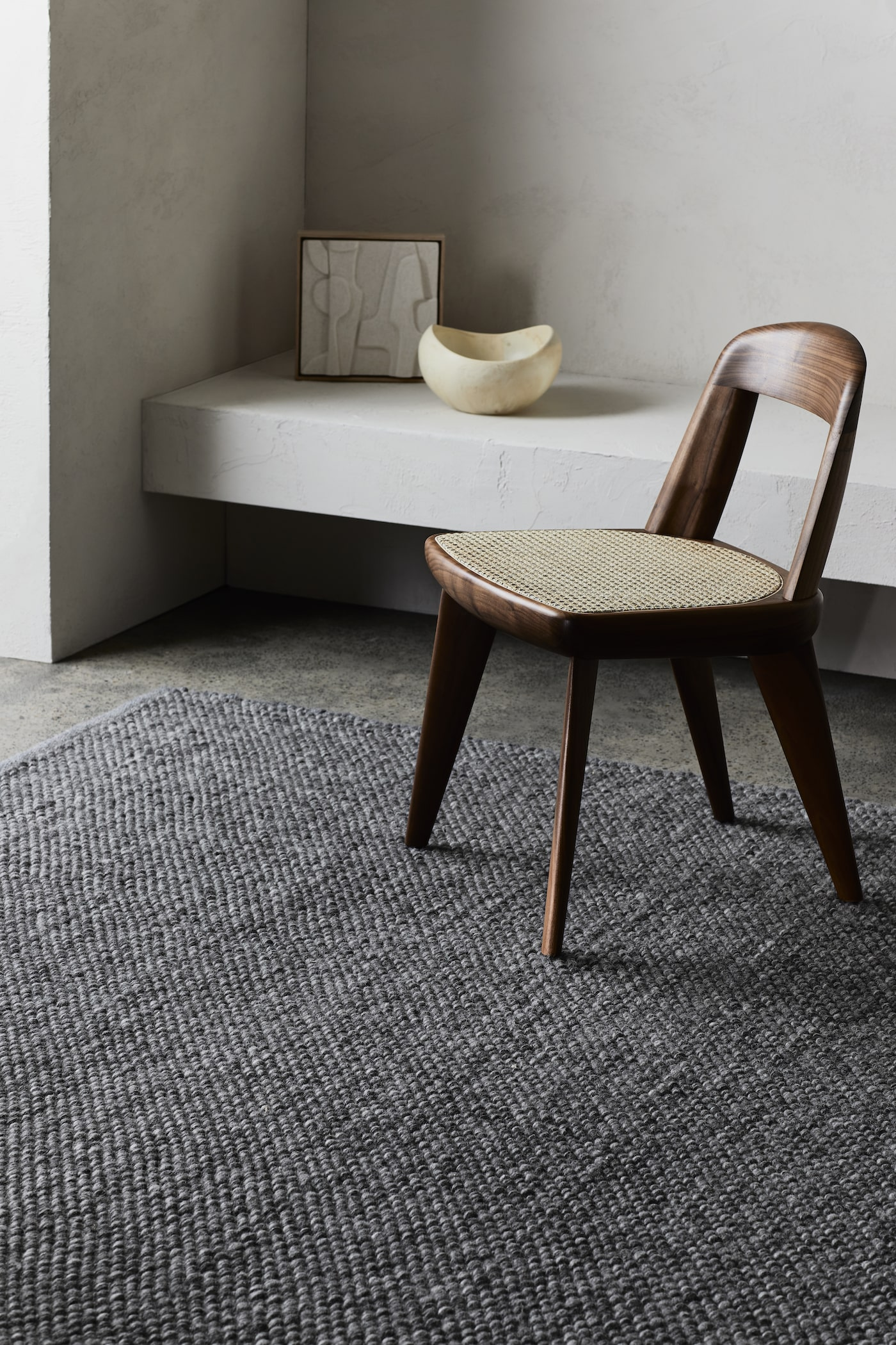 Charcoal rug under timber chair