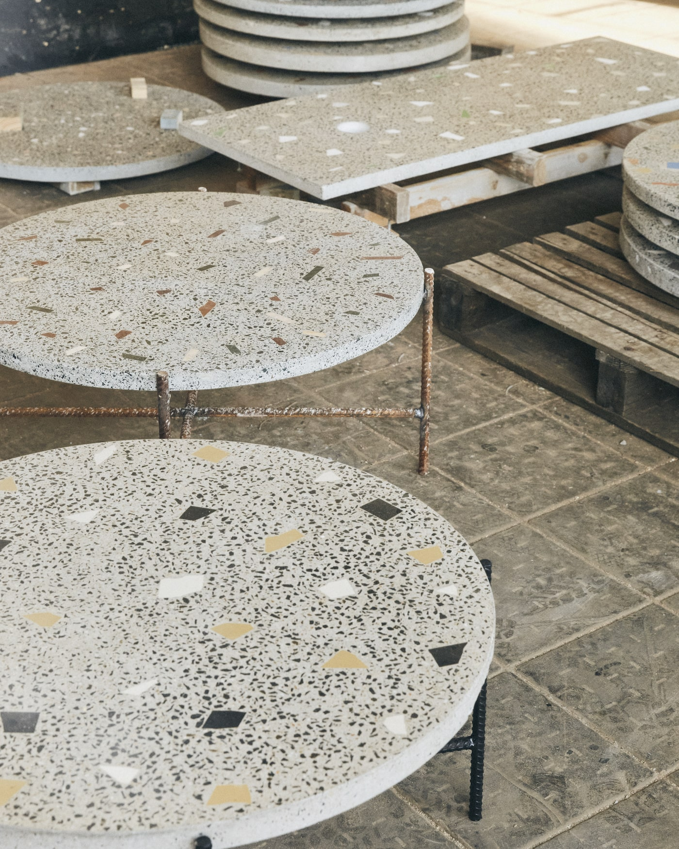 Workshop with concrete terrazzo table tops
