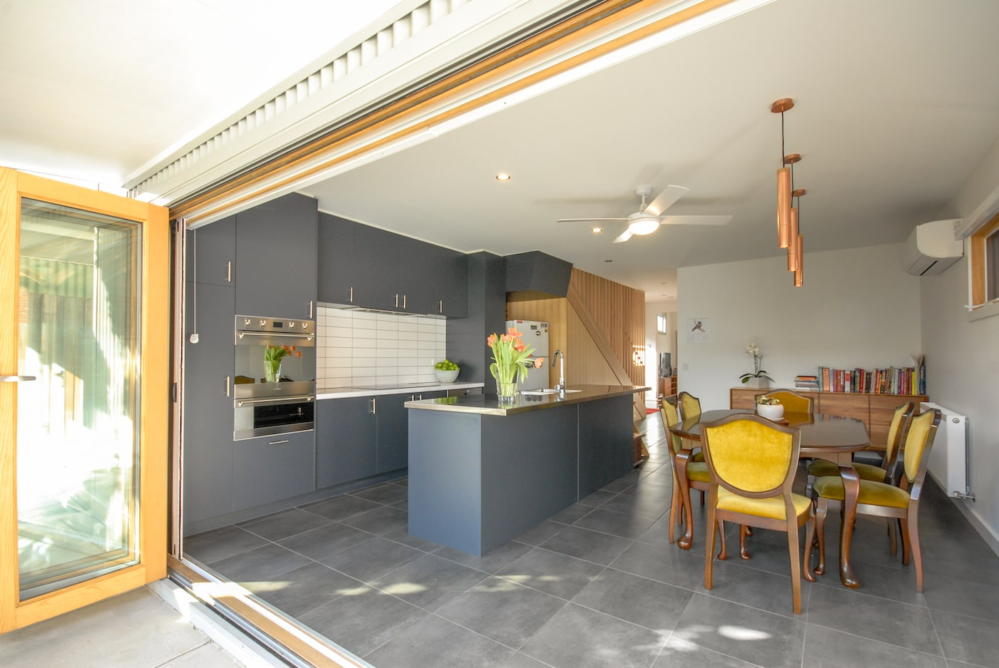 Grey kitchen with charcoal floor tiles