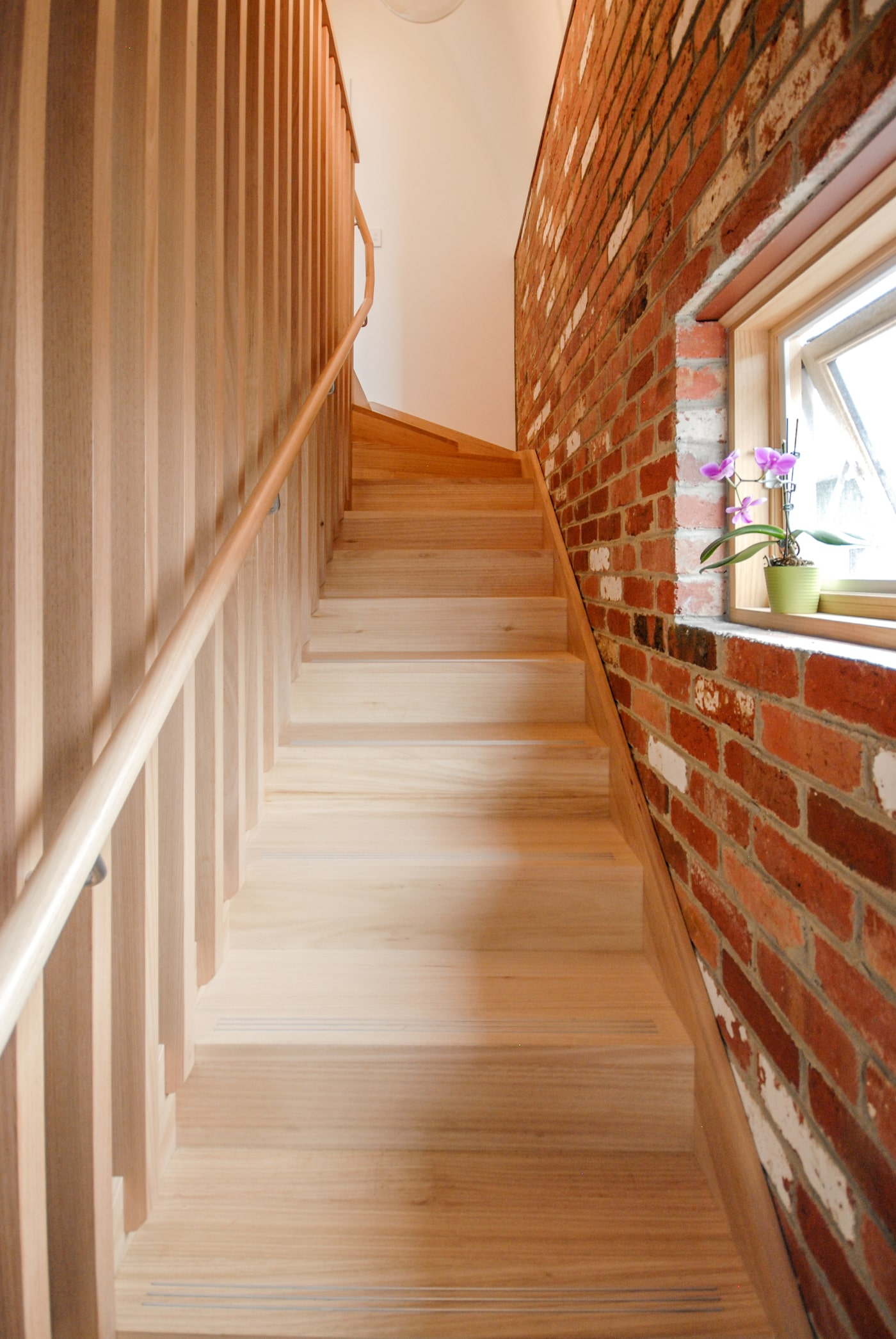 Recycled bricks and timber staircase
